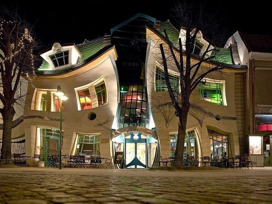 View of the house of the curve in Sopot night