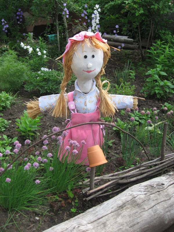 Girl scarecrow pictured the garden