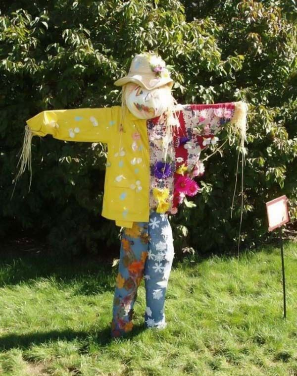 Bright and rustling scarecrow in the garden photo