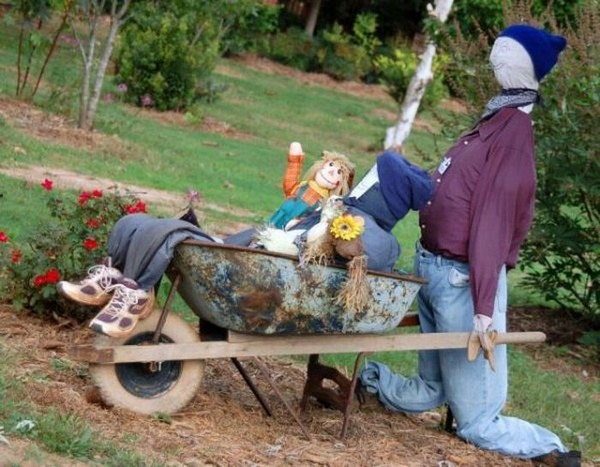Scarecrow kitchen garden with a trolley image