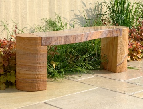 Benches made ​​of stone for the garden and the garden