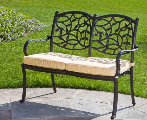 Metal garden bench with upholstered seat