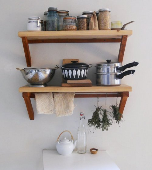Wooden shelves for the kitchen with his hands photo