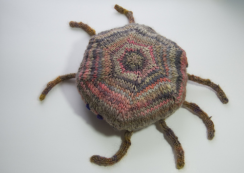 Knitted cushion toy