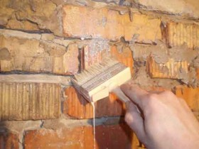 Priming the walls with a brush in hard to reach places