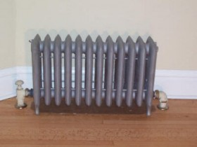 Cast iron radiators on legs
