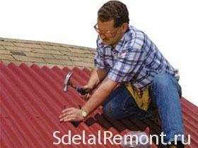Repair roof of the house the roof with his hands photo