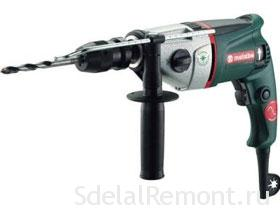 Working with electric drill Photo