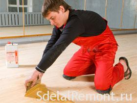 Apply spackling paste to a photo of the parquet.parquet sanding