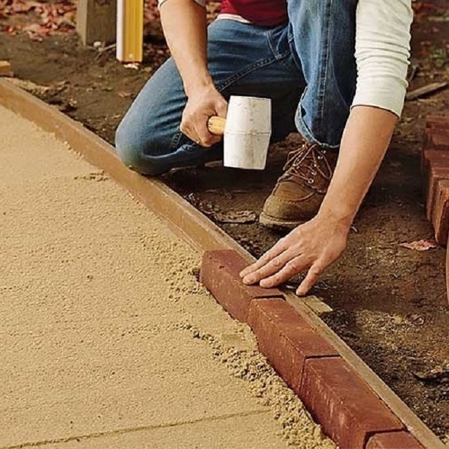 Как выложить брусчатку из камня своими руками 73